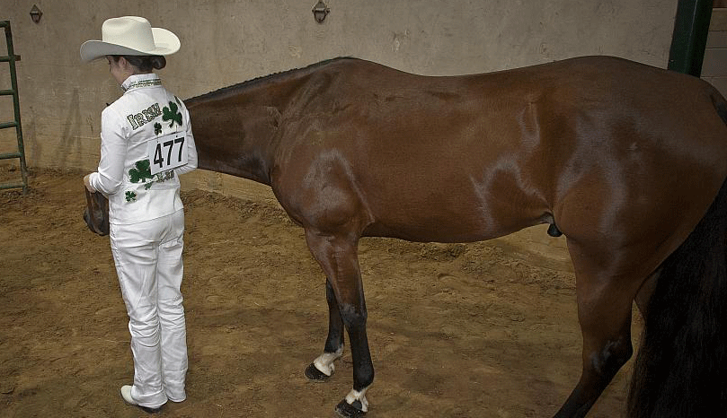 A 4-H'er with her livestock before showing.