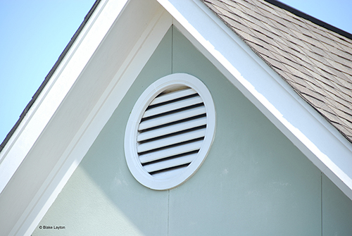 an insect screen behind a gable vent.