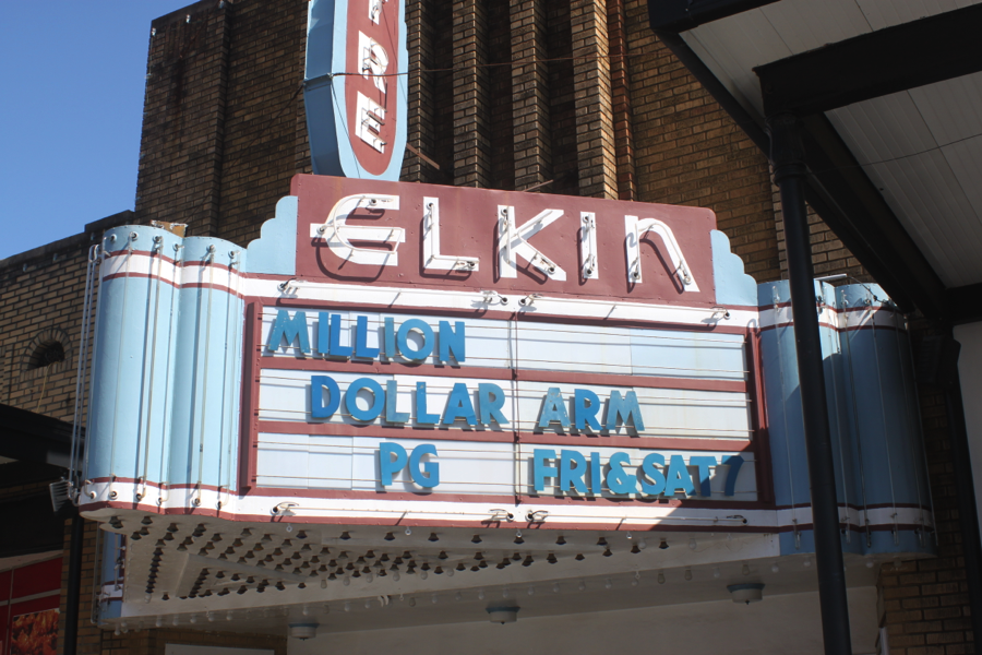 Elkin 'Million Dollar Arm PG Frissat 7' red and blue movie sign.