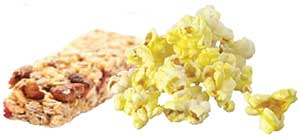 An image of grains - granola bar and popcorn.
