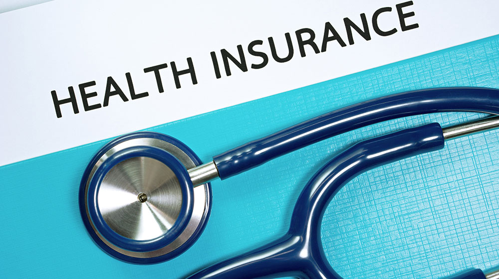This image shows a stethoscope under the words health insurance.
