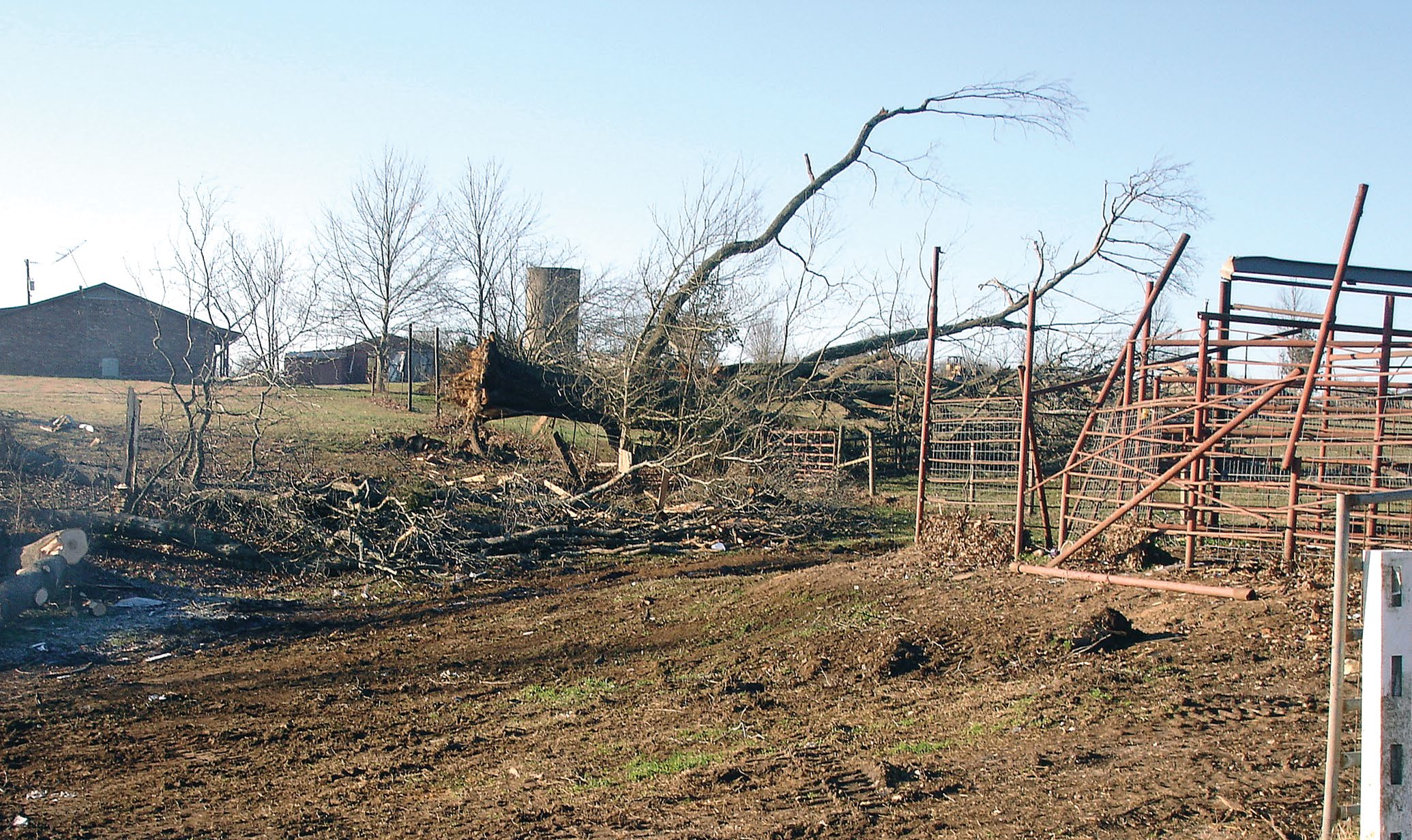 Farmland with debris and property damage caused by a hurricane.