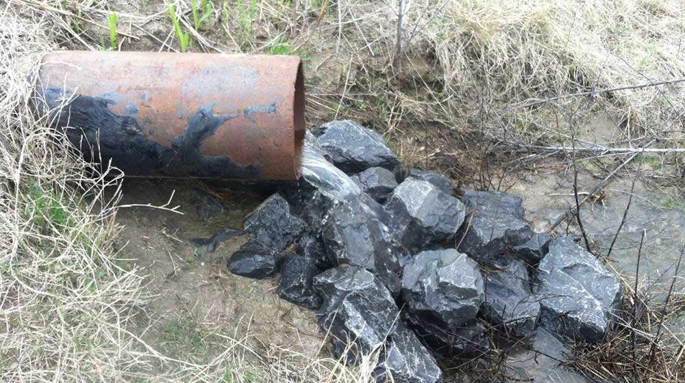 This image shows drainage from pipe letting onto rocks to help with conservation.