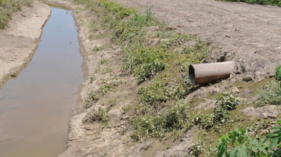 This image shows a slotted inlet pipe used on surface-drained acreage.
