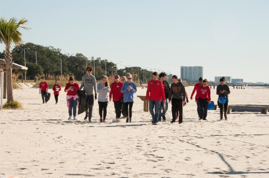 Left: A school group collects trash and data during the Mississippi Coastal Cleanup event. Photo by Agricultural Communications.