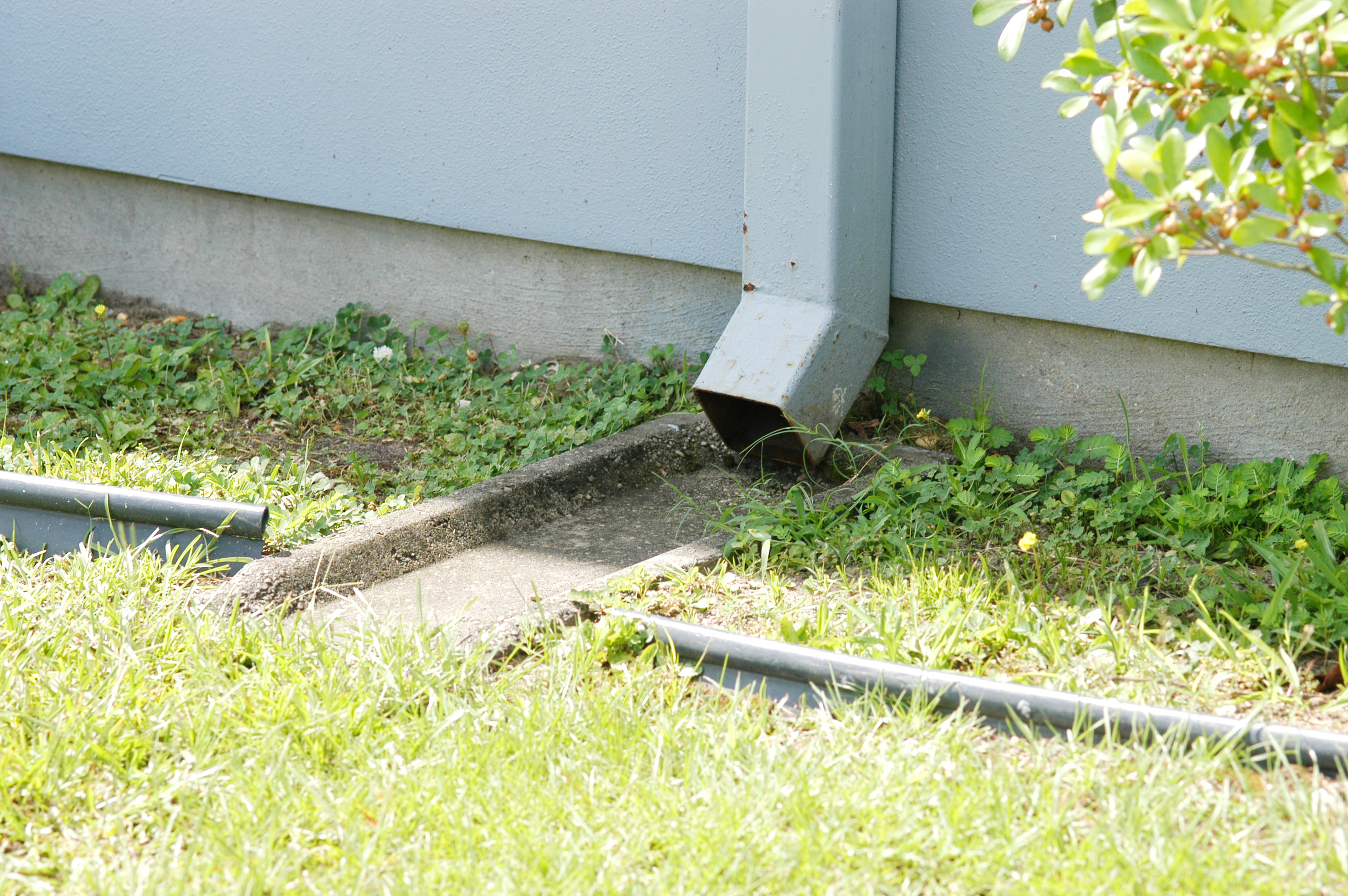 Splash blocks direct water from gutter downspouts away from building foundations and reduce potential for termite infestation by preventing soil movement and slowing the breakdown of termiticide barriers.