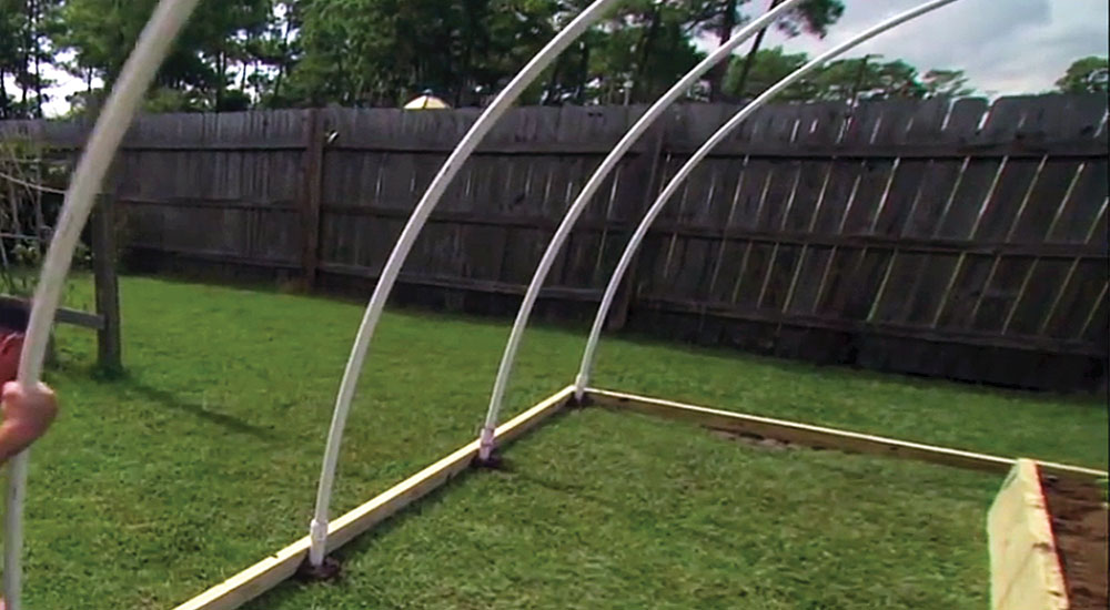 Step 7: Repeat the process to make and install the other three 20-foot bows on the remaining galvanized pipes.