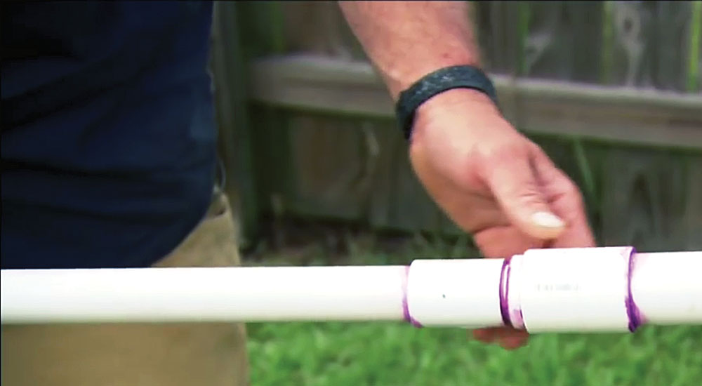Step 4: Glue a 6-inch section of 1¼-inch PVC pipe to each end of a 1-inch-wide, 20-foot-long PVC pipe using the PVC reducing couplings.