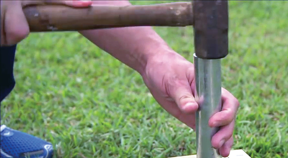 Step 3: Set the galvanized pipe using a hammer, leaving about 6 inches of pipe above the baseboards. At this point, you could use concrete to stabilize each post if you dug holes larger than the diameter of the galvanized pipe.