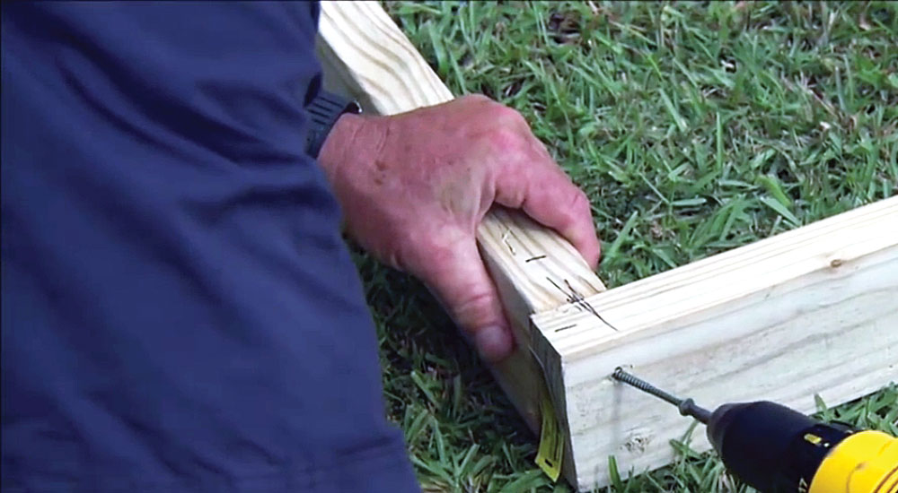 Step 1: Line up the 2X4-inch baseboards—two 10-foot boards and two 12-foot boards. Secure them with 2½-inch deck screws. (The 11 building instruction photos were provided by Ask This Old House.)
