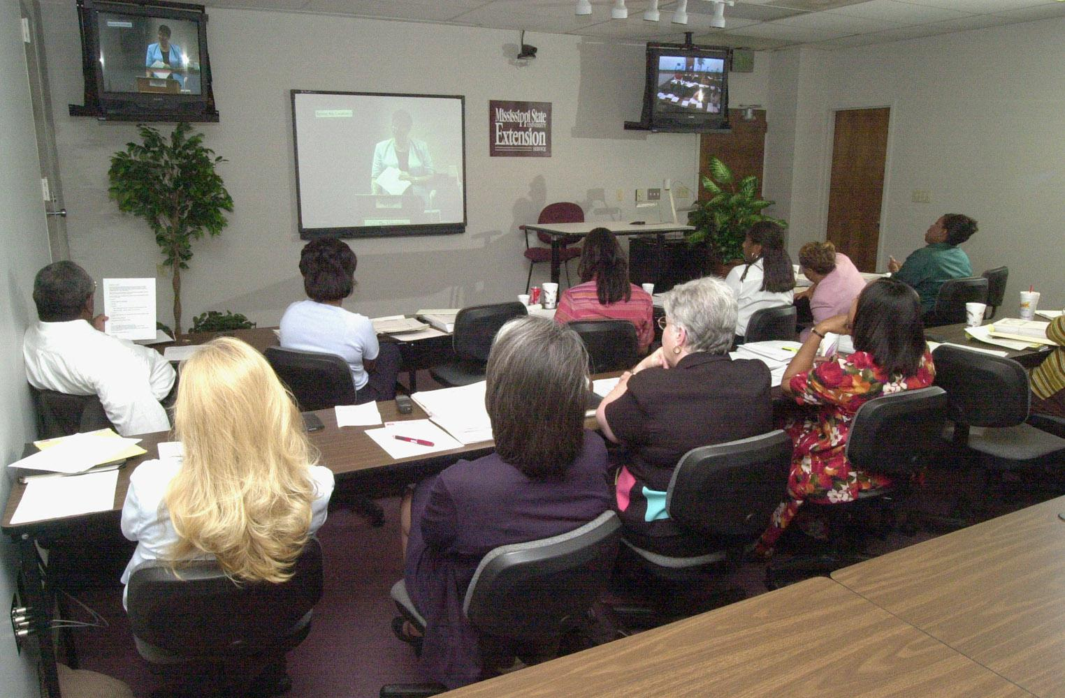 Video conferences reduce the travel necessary for both the presenters and the participants.