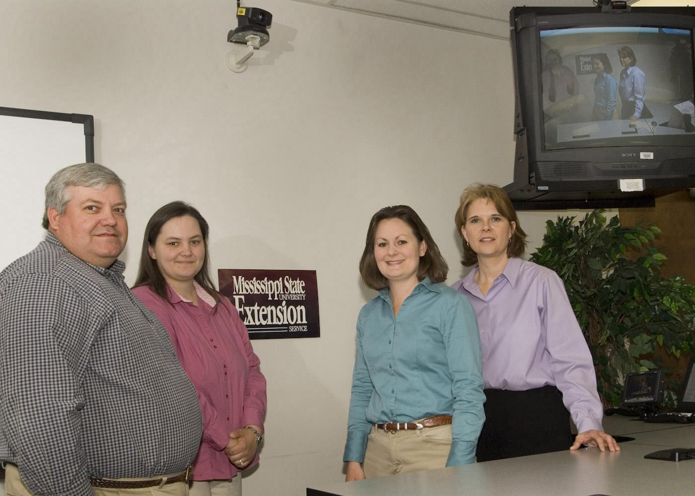 The MSU Extension Service distance education program team members include (from left) Steve Hankins, Susan Fulgham, Jane Parish and Susan Seal. (Photo by Marco Nicovich) See larger view.