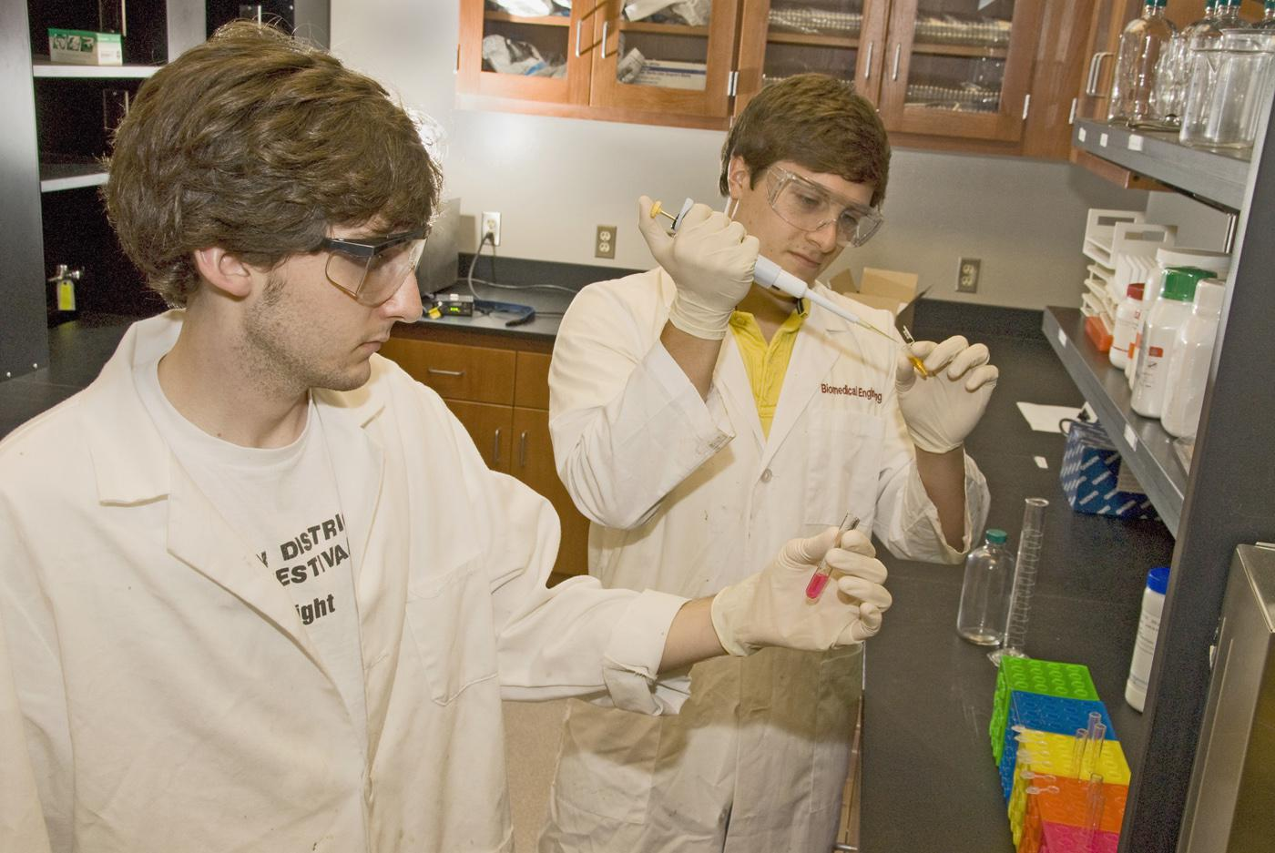 Mississippi State University biological engineering students Sam Pote of Starkville, left, and Caleb Dulaney of Collinsville conduct their research project on isolating an enzyme that initiates lignin breakdown in plant cells. (Photo by Marco Nicovich)