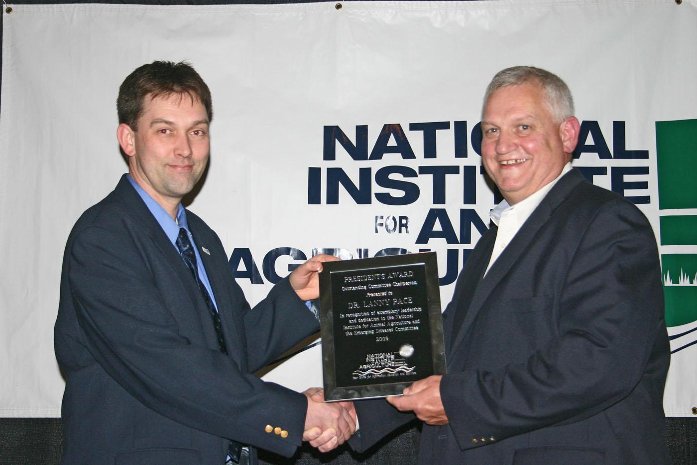 Dr. Lanny Pace (right), executive director of the Mississippi Veterinary Diagnostic and Research Laboratory System, receives the National Institute for Animal Agriculture President's Award for exemplary leadership and dedication to the Institute from Dr. Robert Fourdraine, NIAA vice chair. (Submitted photo)