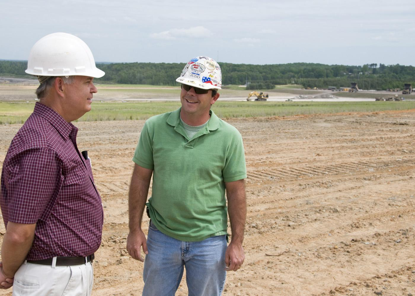 MAFES agronomist David Lang, left, talks with North American Coal environmental specialist Judd Sanborn about preparations for planting switchgrass on reclaimed mine land. (Photo by Marco Nicovich)