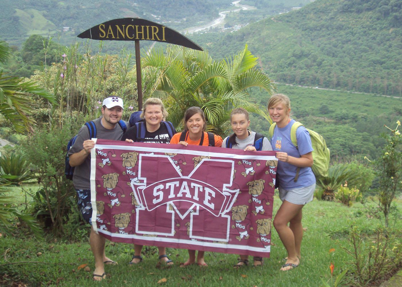 Mississippi State University College of Veterinary Medicine students (from left to right) Brolin Evans, Katie Cooley, Kellie Horton, Stephanie Starling and Brittany Fisher display their MSU pride while volunteering in Sanchiri, Costa Rica. (Photo submitted)