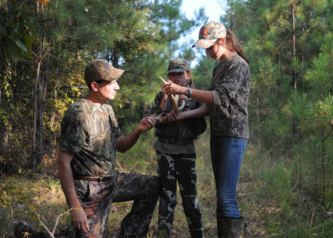 Darren Miller and his daughters Heidi and Hannah enjoy hunting on their family's land in Oktibbeha County. The state's economy benefits from the many Mississippians who engage in wildlife recreation. (Photo by Kat Lawrence)