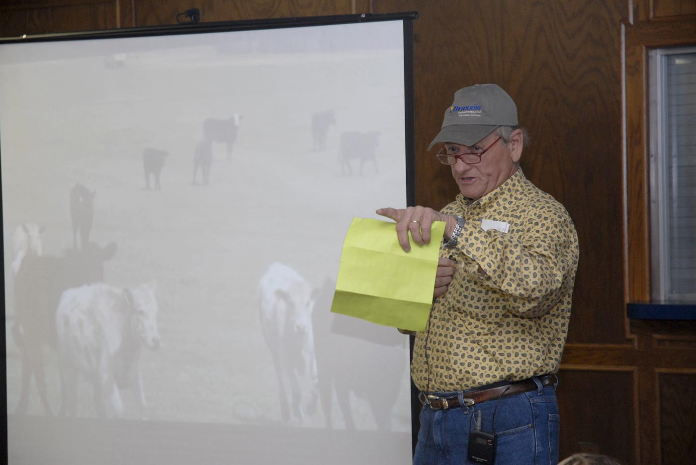 Ray Welch, owner of Winona Stockyards, serves as the auctioneer for the Cattlemen's Exchange and Homeplace Producer Sale held in April. Buyers see video segments and read descriptions of cattle lots as they bid on the animals. More than 2,000 cattle were sold in less than an hour with total receipts approaching $1.9 million. (Photo by Linda Breazeale)