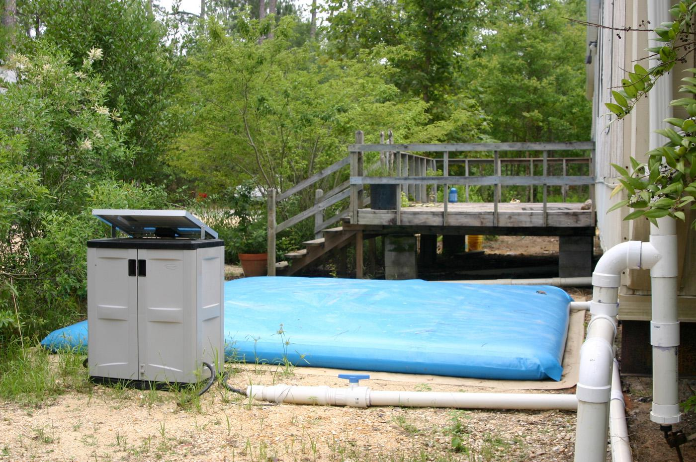 A rainwater harvesting system donated to the Crosby arboretum by Avon Engineered Fabrications collects run-off in a flexible storage tank. (Submitted photo.)