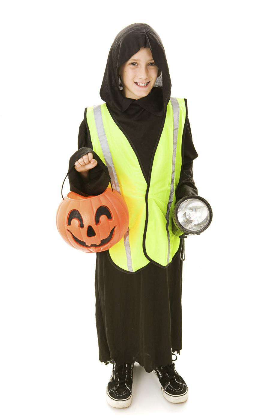 Safety experts advise trick-or-treaters to carry a flashlight, wear shoes that fit properly, avoid long costumes that could cause tripping and use reflective tape on costumes and candy buckets. (Photo by Lisa F. Young/Photos.com)