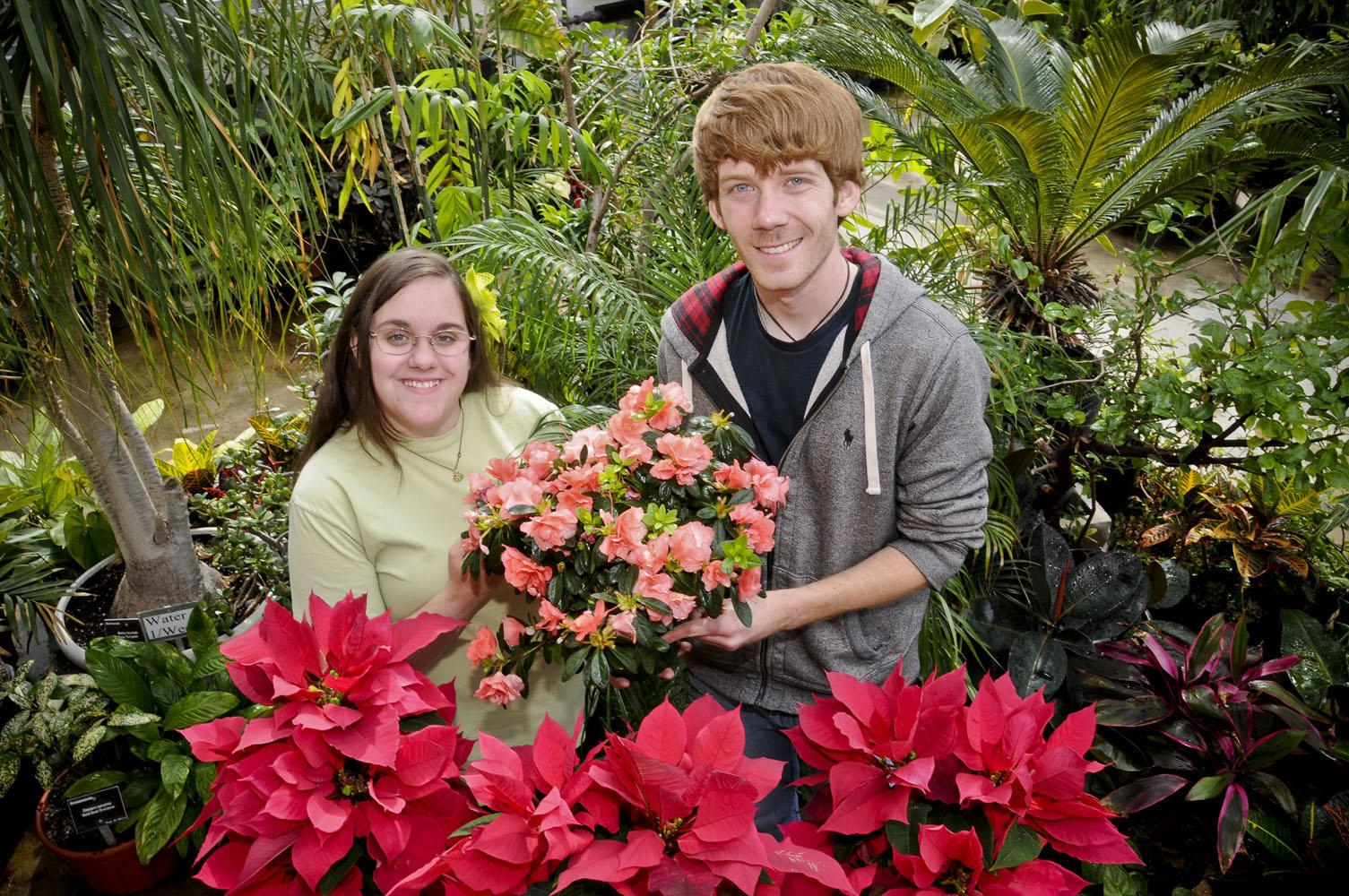Mississippi State University Horticulture Club members Deanna Lyle of Aberdeen and Josh Craver of Tyler, Texas, prepare plants to be sold at the Everything Garden Expo to be held at the Mississippi Horse Park in Starkville March 24 and 25. (Photo by Scott Corey)
