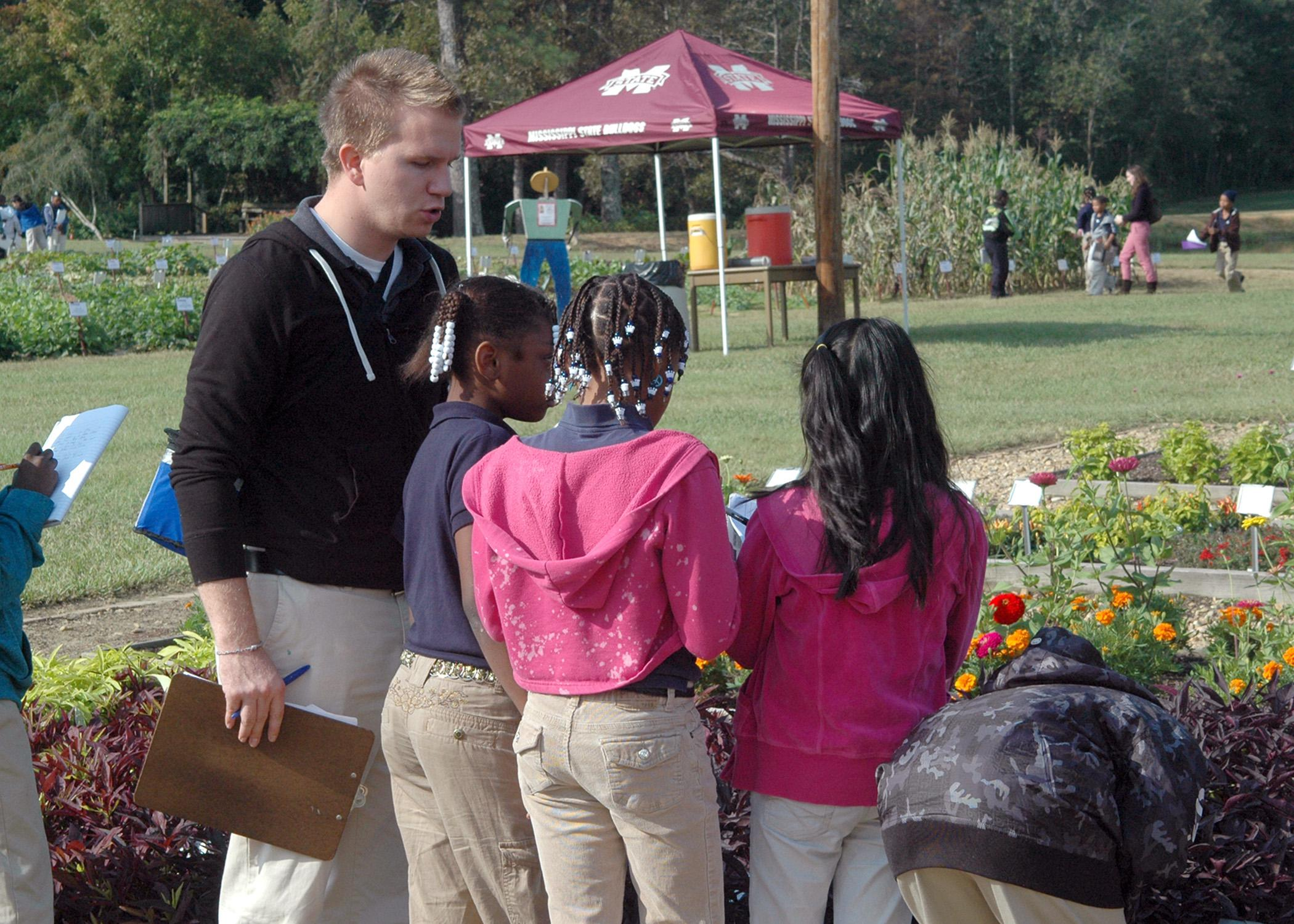 Emory Williamson, a fourth-grade teacher at Hazlehurst Elementary School, instructs his students to write down names of plants they saw during the Youth Fall Gardening Fest Oct. 9 and 10 at the Truck Crops Branch Experiment Station in Crystal Springs. (MSU Ag Communications/Susan Collins-Smith)