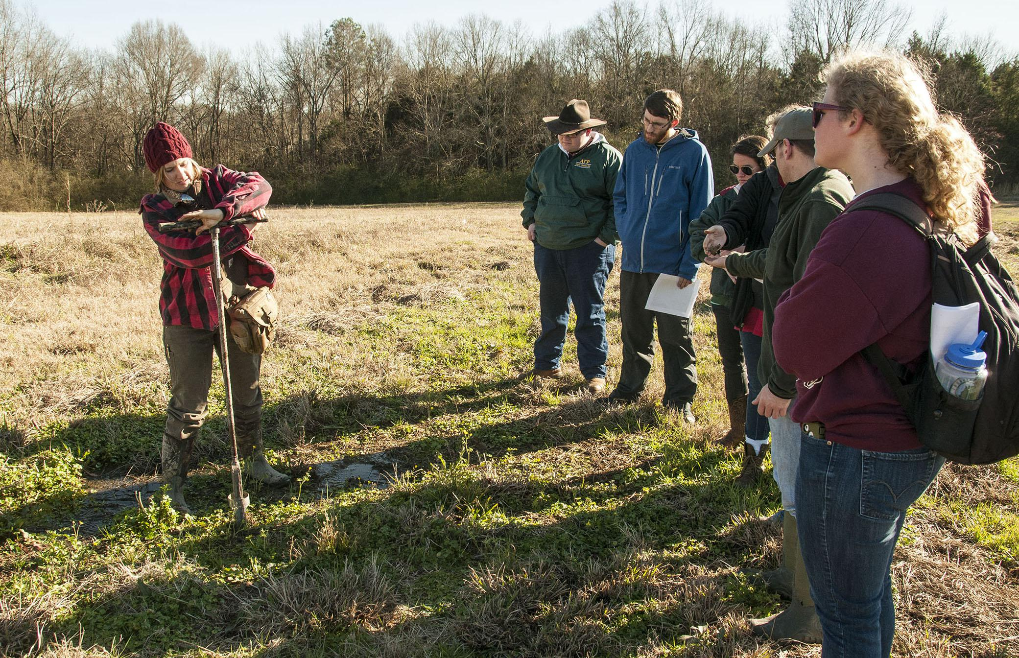 Rachel Stout Evans, a soil scientist with the Natural Resources Conservation Service, takes soil samples on Feb. 1, 2013, at the newly established Mississippi State University student farm to show students how soil types drive decision-making for land use. (Photo by MSU Ag Communications/Scott Corey).