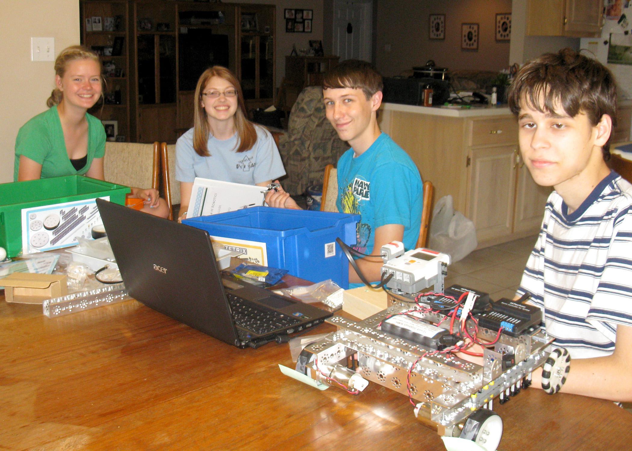 The Pearl River County senior 4-H Robotics team, from left Elsa Schmitz, Emily Bordelon, Bradley Guillot and Eric Bordelon, plans robot construction to prepare for an annual robotics contest. (Submitted Photo)