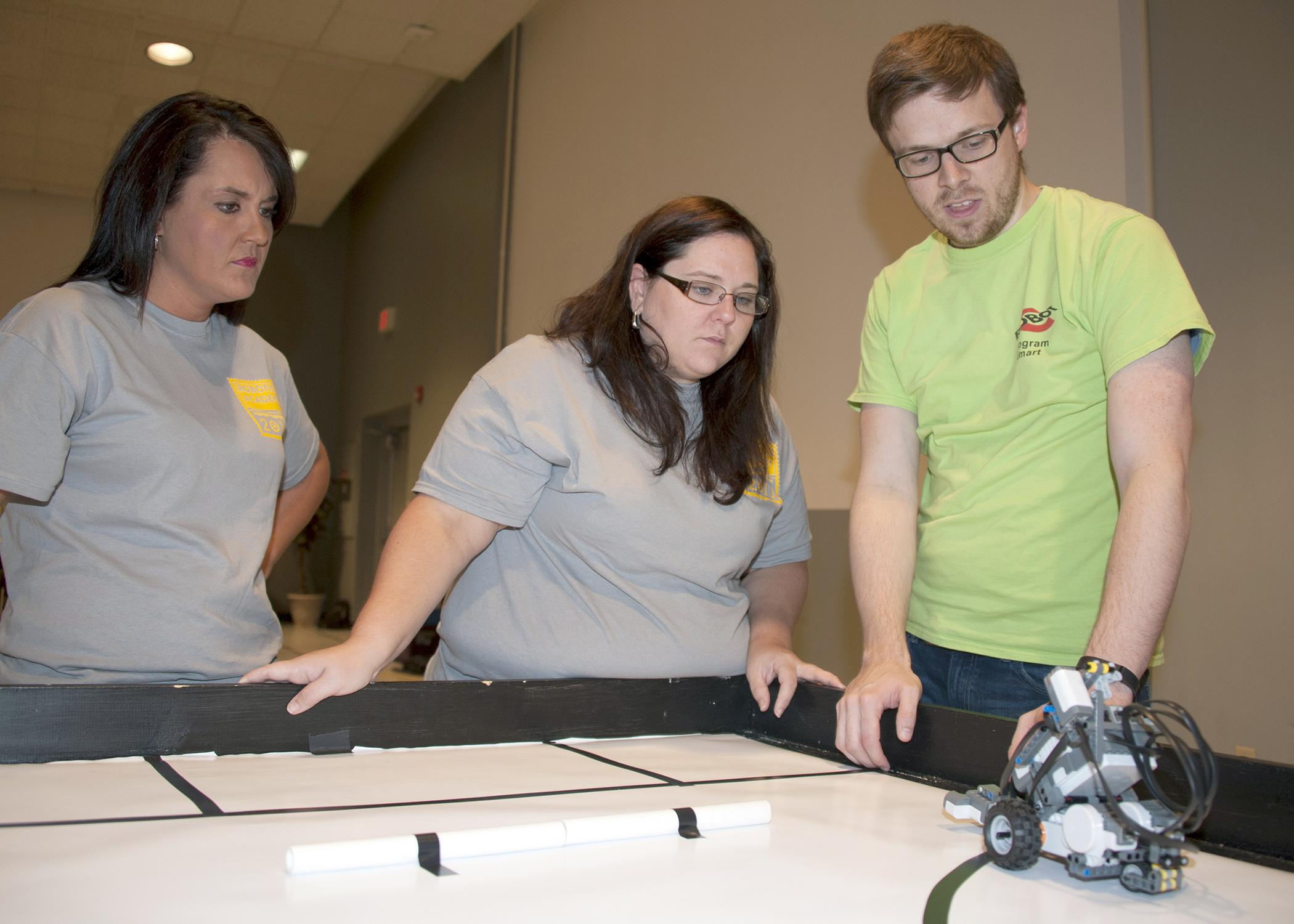 Betsy Padgett, Holmes County Extension agent, and Christina Meriwether, Leflore County Extension agent, learn how to program robots at Mississippi State University's 4-H Robotics Academy on Aug. 13, 2013. (Photo by MSU Ag Communications/Kat Lawrence)