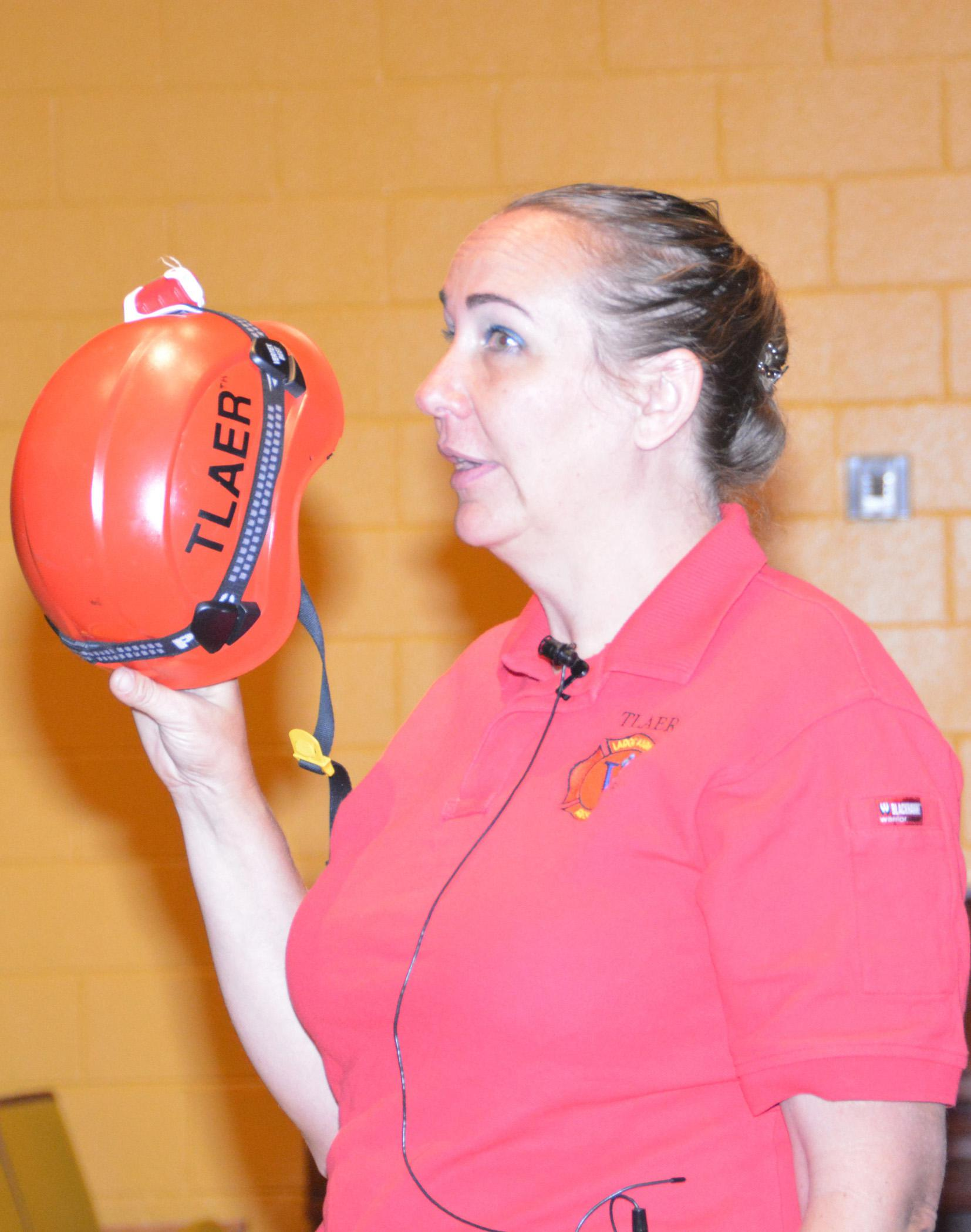 Dr. Rebecca Gimenez, an instructor for the Technical Large Animal Emergency Response course at Mississippi State University on March 29, 2014, explains that head protection is essential when people are helping large, distressed animals. (Photo by MSU Ag Communications/Linda Breazeale)