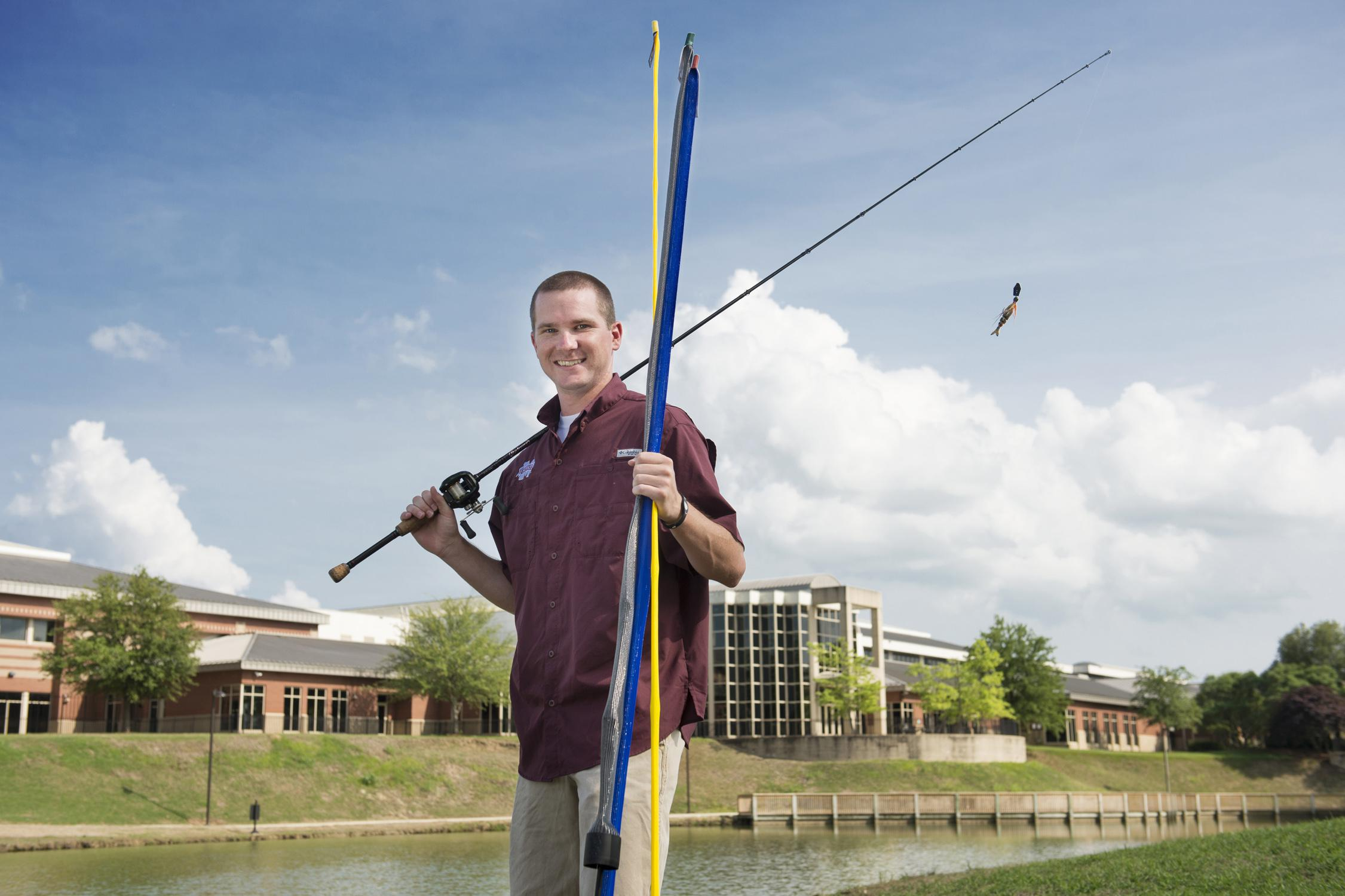 Mississippi State University senior Charles Parker recently won $10,000 during MSU's Office of Entrepreneurship and Technology Transfer Entrepreneurship Week for his fishing pole protectors, called Rod Sox. Parker is shown here at MSU's Chadwick Lake on May 13, 2014. (Photo by MSU Office of Public Affairs/Megan Bean)