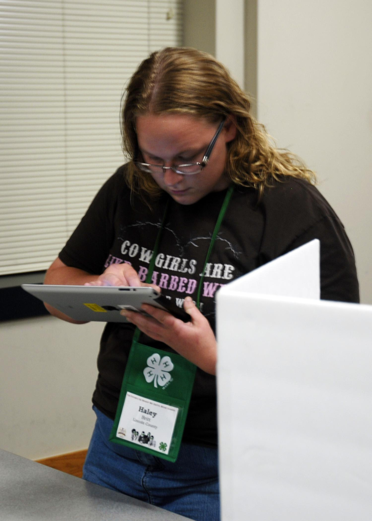 Haley Britt of Lincoln County uses an iPad instead of a paper ballot on May 28, 2014 to vote for State 4-H Council officers during the annual 4-H Club Congress at Mississippi State University. (Photo by MSU Ag Communications/Libby Durst)