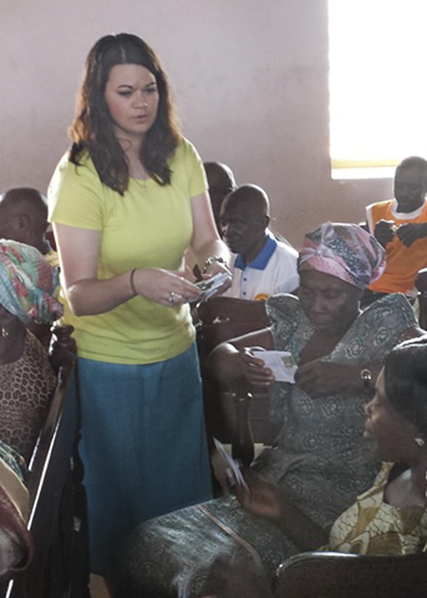 Mississippi State University graduate student Alyssa Barrett hands out moringa seeds to participants of an agricultural education workshop in Ghana. Barrett collected data on the effectiveness of the workshop. (Submitted Photo)