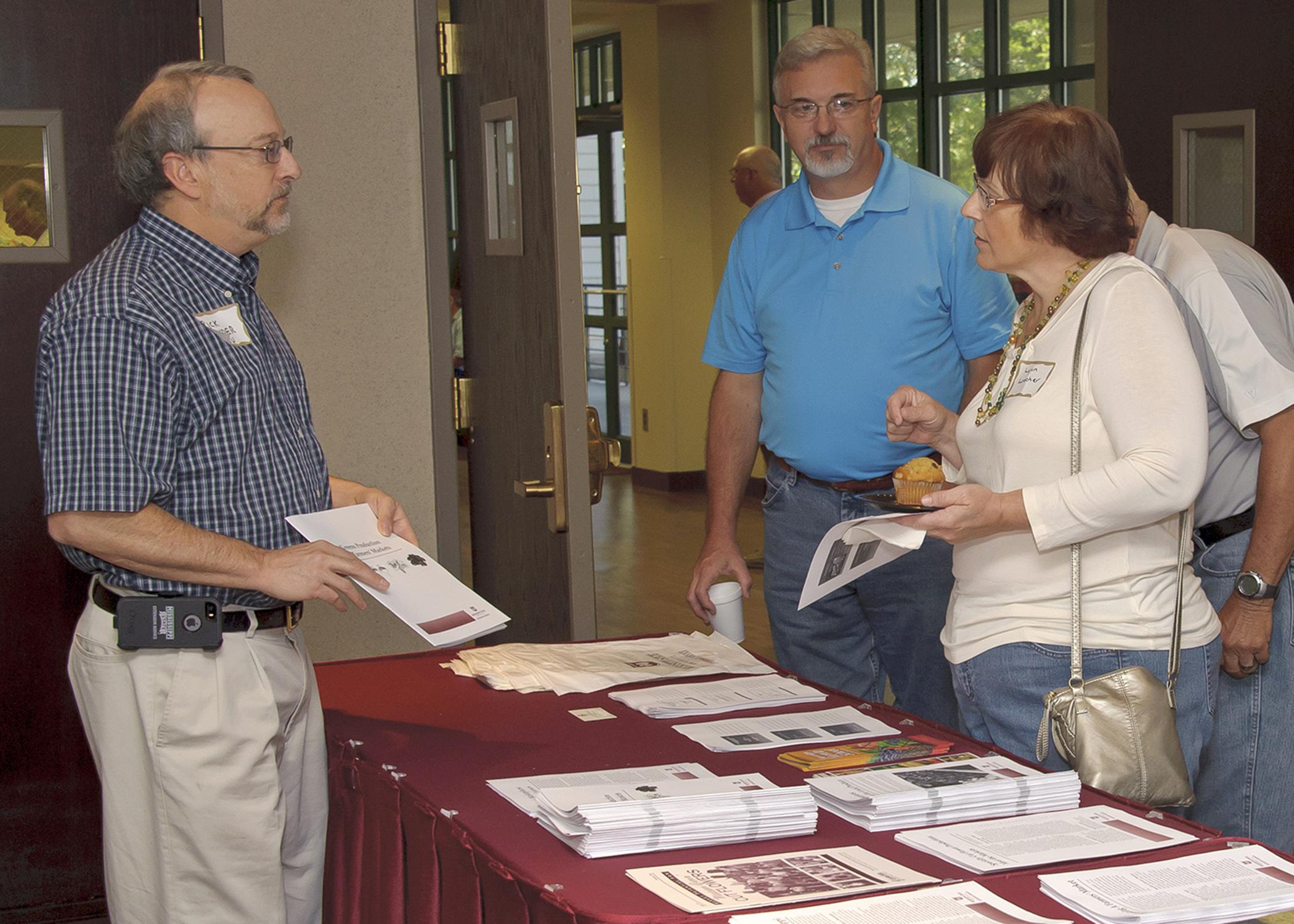 Rick Snyder, Mississippi State University horticulture expert, talks to Joseph Wilson, center, and Lynn Loecher at the microfarming workshop in Raymond on Aug. 28, 2014. The two-day event helped growers understand the benefits and facts of growing for and selling at farmers markets. (Photo by MSU Ag Communications/Kevin Hudson)