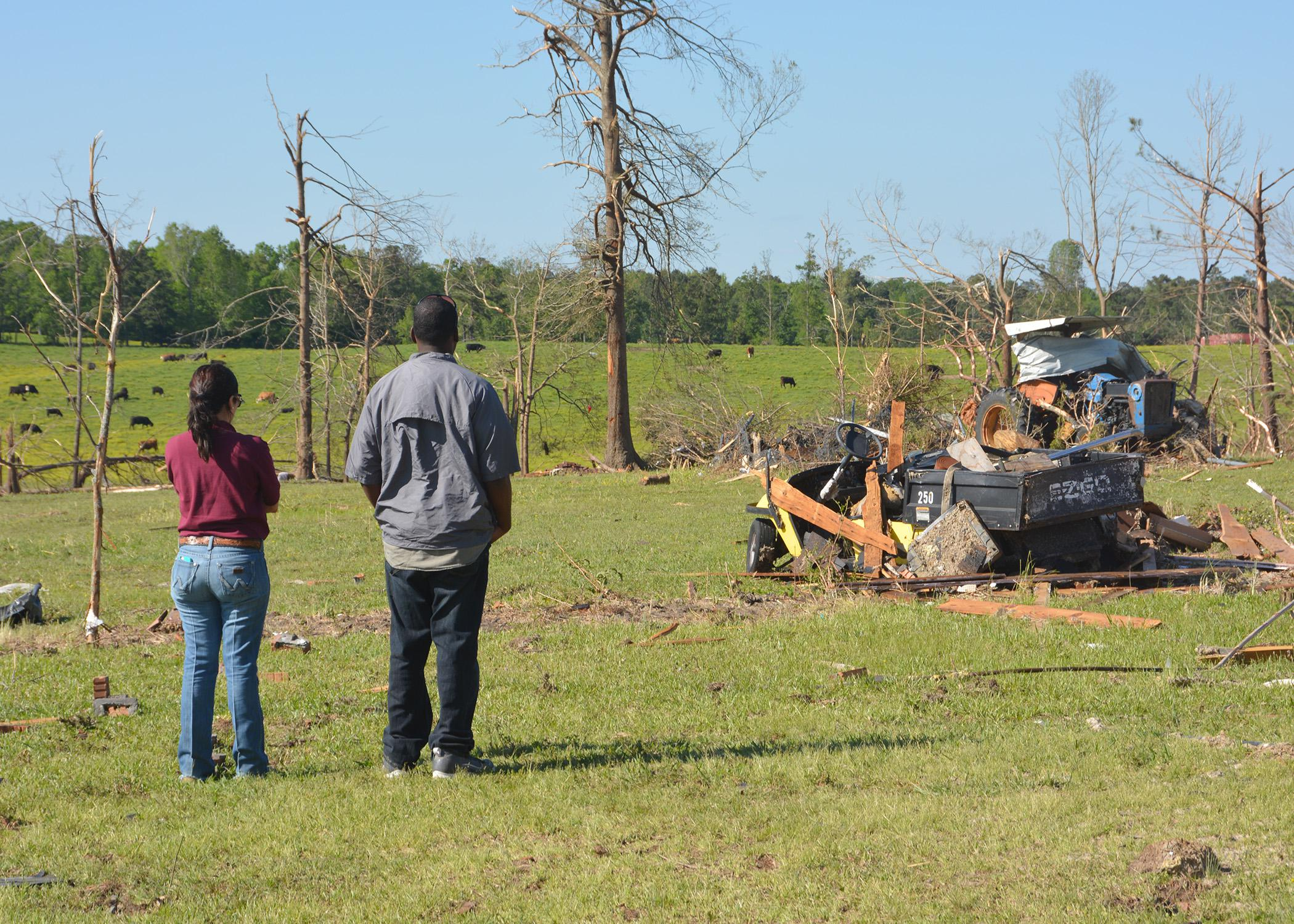 A specialist with the Mississippi State University Extension Service surveys agricultural damage with a Winston County resident following the tornado that hit on April 28, 2014. A grant will enable Extension to re-evaluate disaster efforts in communities across the state. (File photo by MSU Ag Communications/Linda Breazeale)