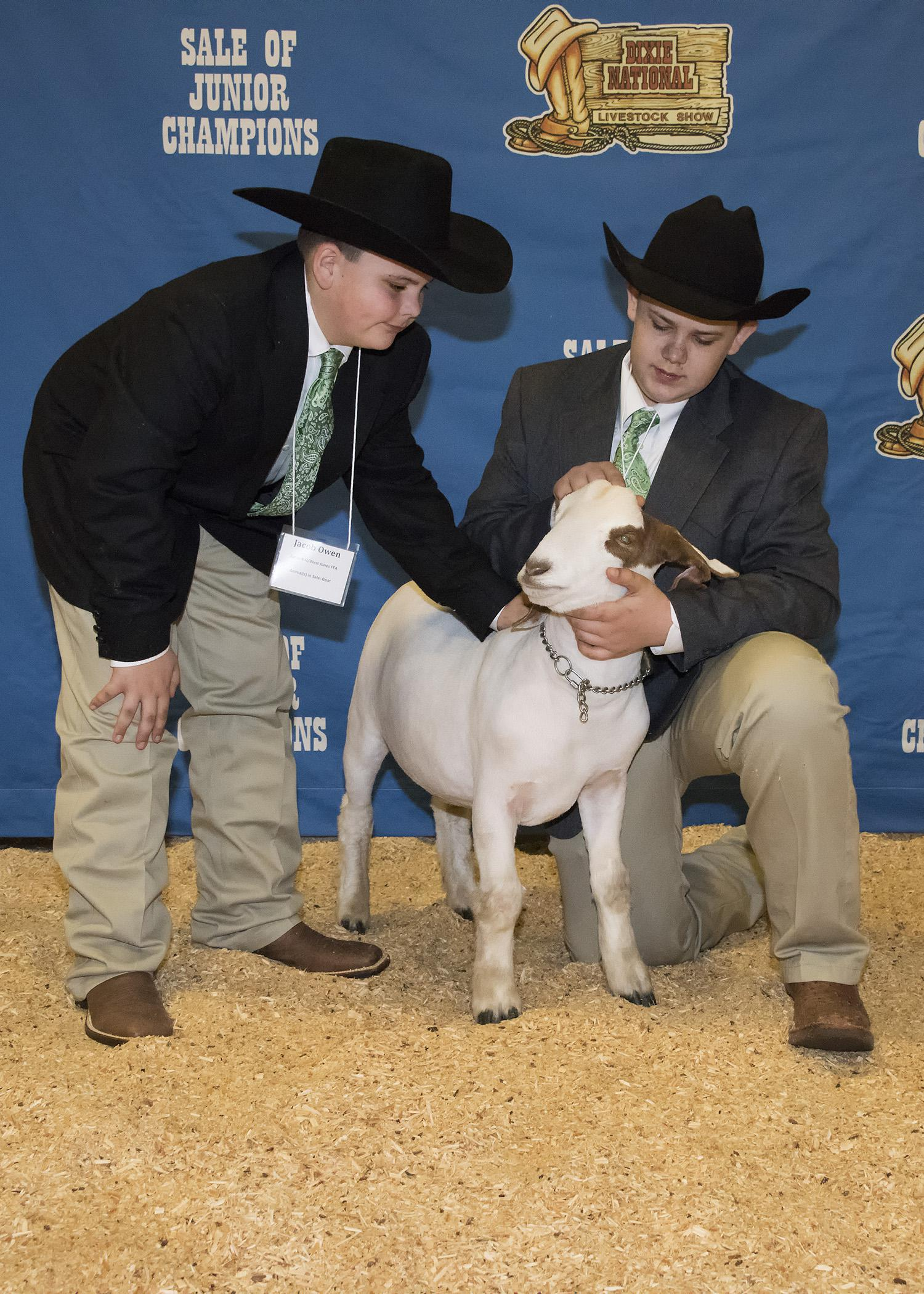 Jacob Owen, left, and his older brother, Tyler, prepare to enter the arena for the Dixie National Sale of Junior Champions with their market goat, Splits, on Feb. 12, 2015, in Jackson, Mississippi. (Photo by MSU Ag Communications/Kevin Hudson)