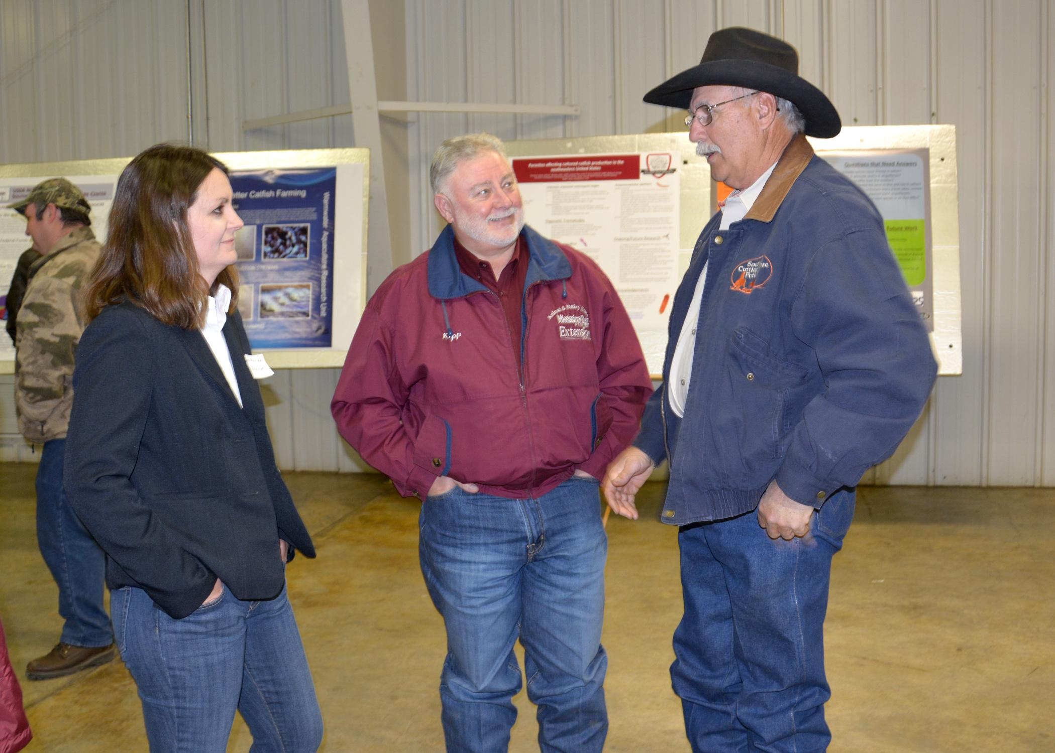 Jane Parish, extension and research professor of animal science with Mississippi State University, and Kipp Brown, area extension associate in Carroll County, visit with Webster County horseman John Fondren at the North Mississippi Research and Extension Center Producer Advisory Council meeting in Verona, Mississippi, on Feb. 19, 2015. (Photo by MSU Ag Communications/Linda Breazeale)