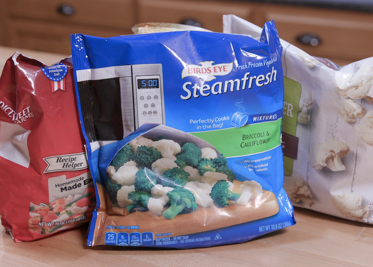Three bags of frozen food sit on a counter.