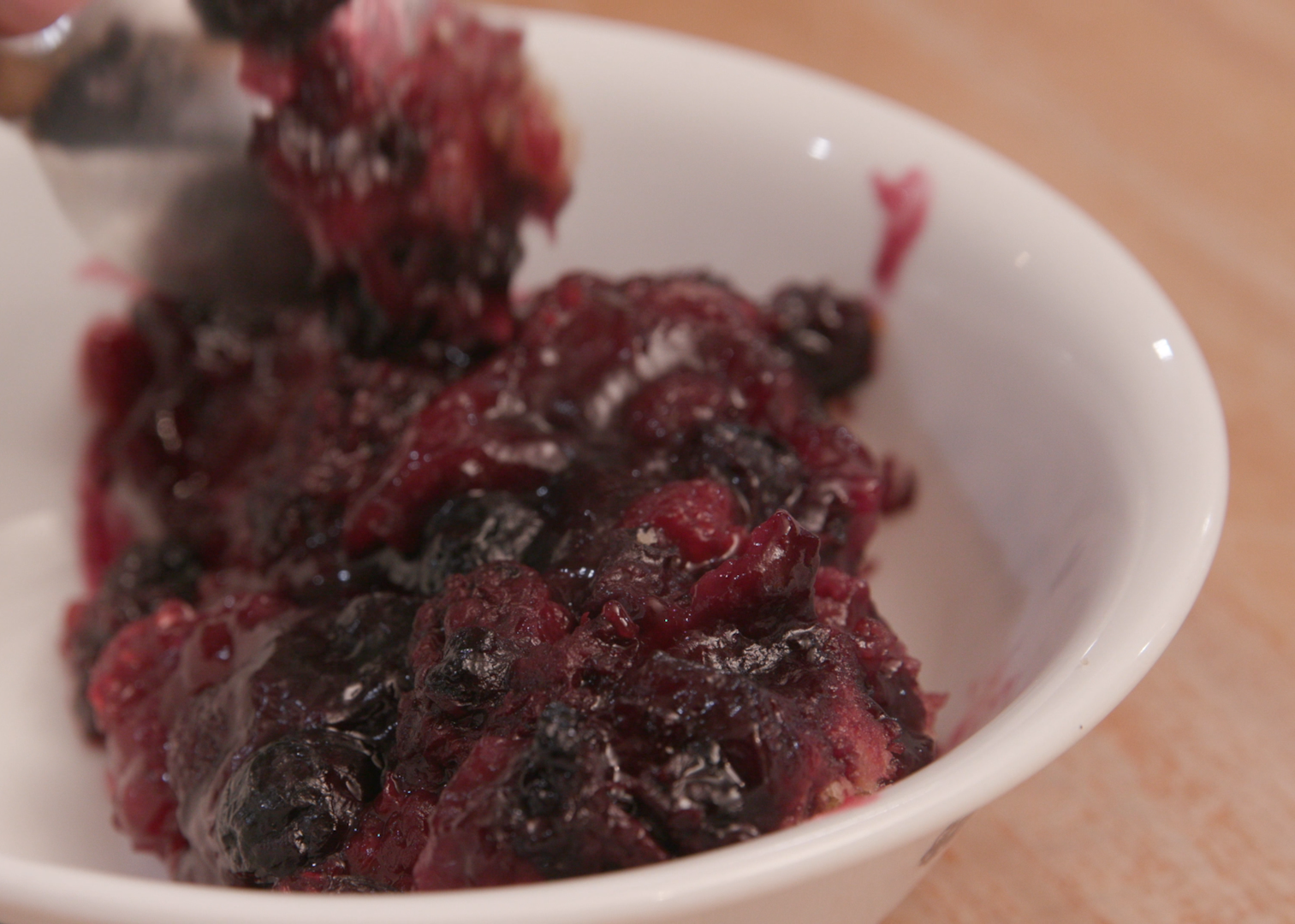 berry cobbler in a bowl.