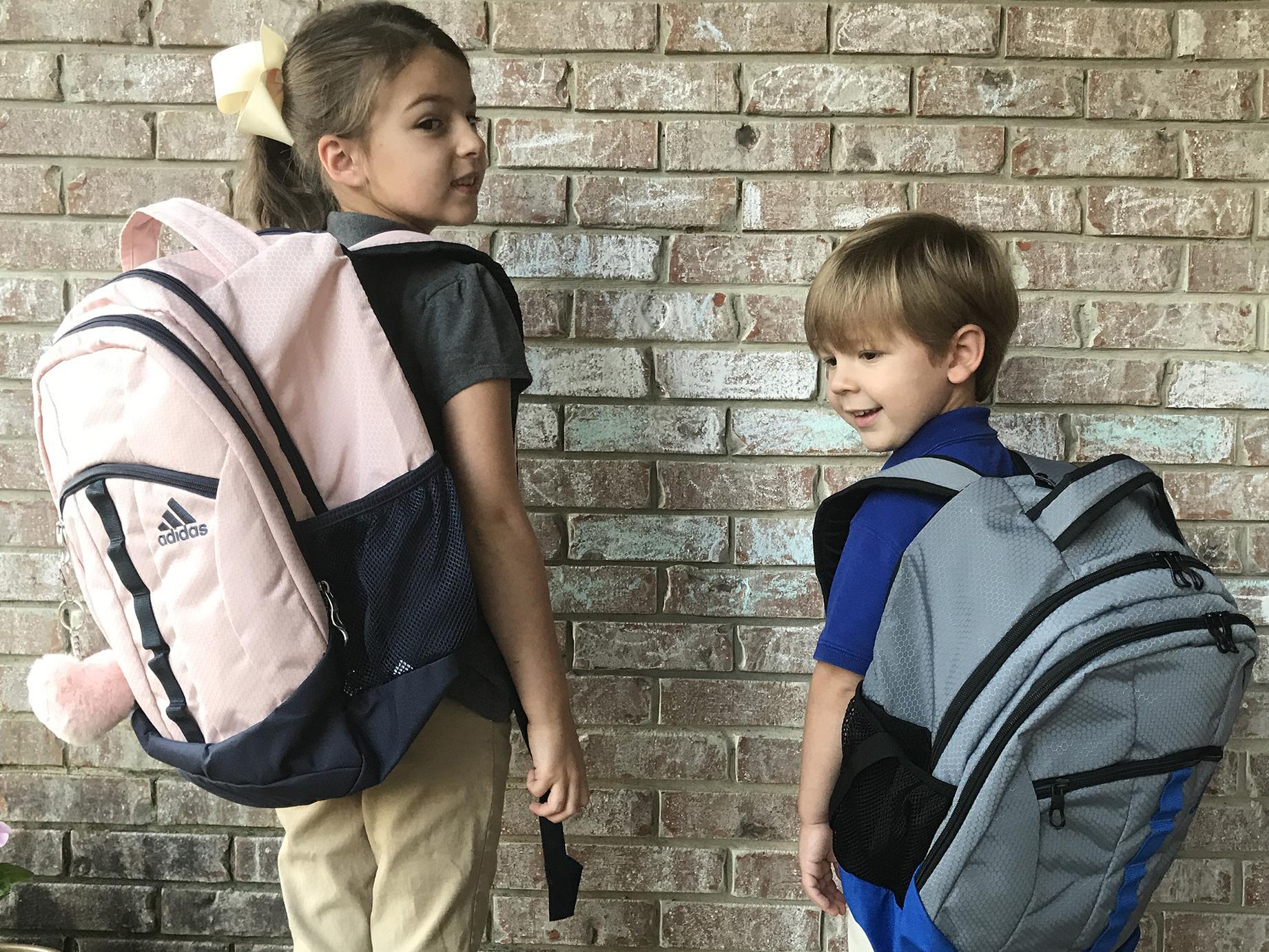 Two children with school backbacks