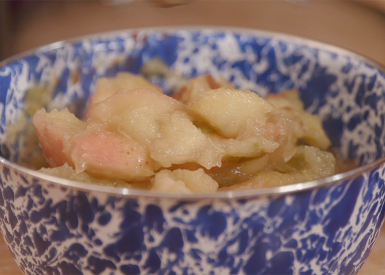 Homemade applesauce in a blue and white enamel bowl.