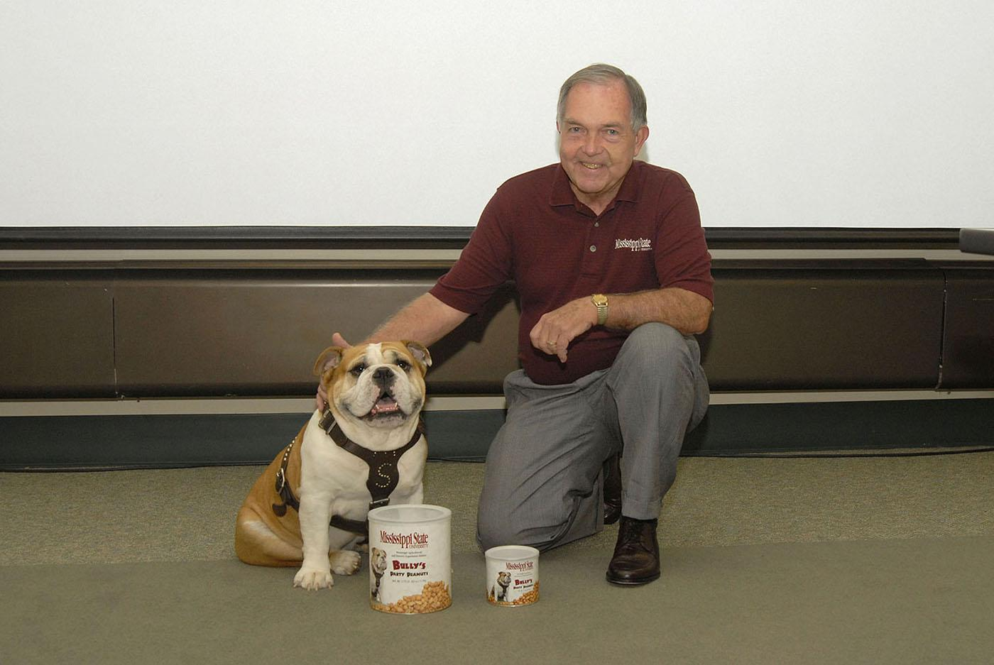 The Mississippi State University Cheese Store now sells peanuts to help promote consumption in the state. Pictured with two of the products are Bully, MSU's mascot, and Dr. Vance Watson, vice president for the Division of Agriculture, Forestry and Veterinary Medicine. Photo by Tom Thompson.