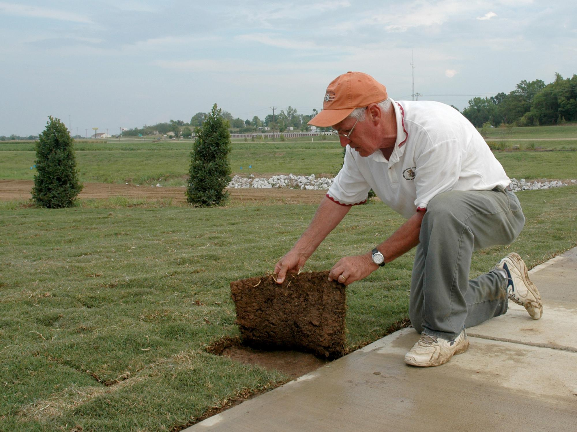 Mississippi State University Extension turf specialist Wayne Wells inspects newly laid sod during the establishment of the Veterans Memorial Rose Garden, near the entrance to the R. Rodney Foil Plant Science Research Facility. (File photo by MSU Ag Communications/Linda Breazeale)