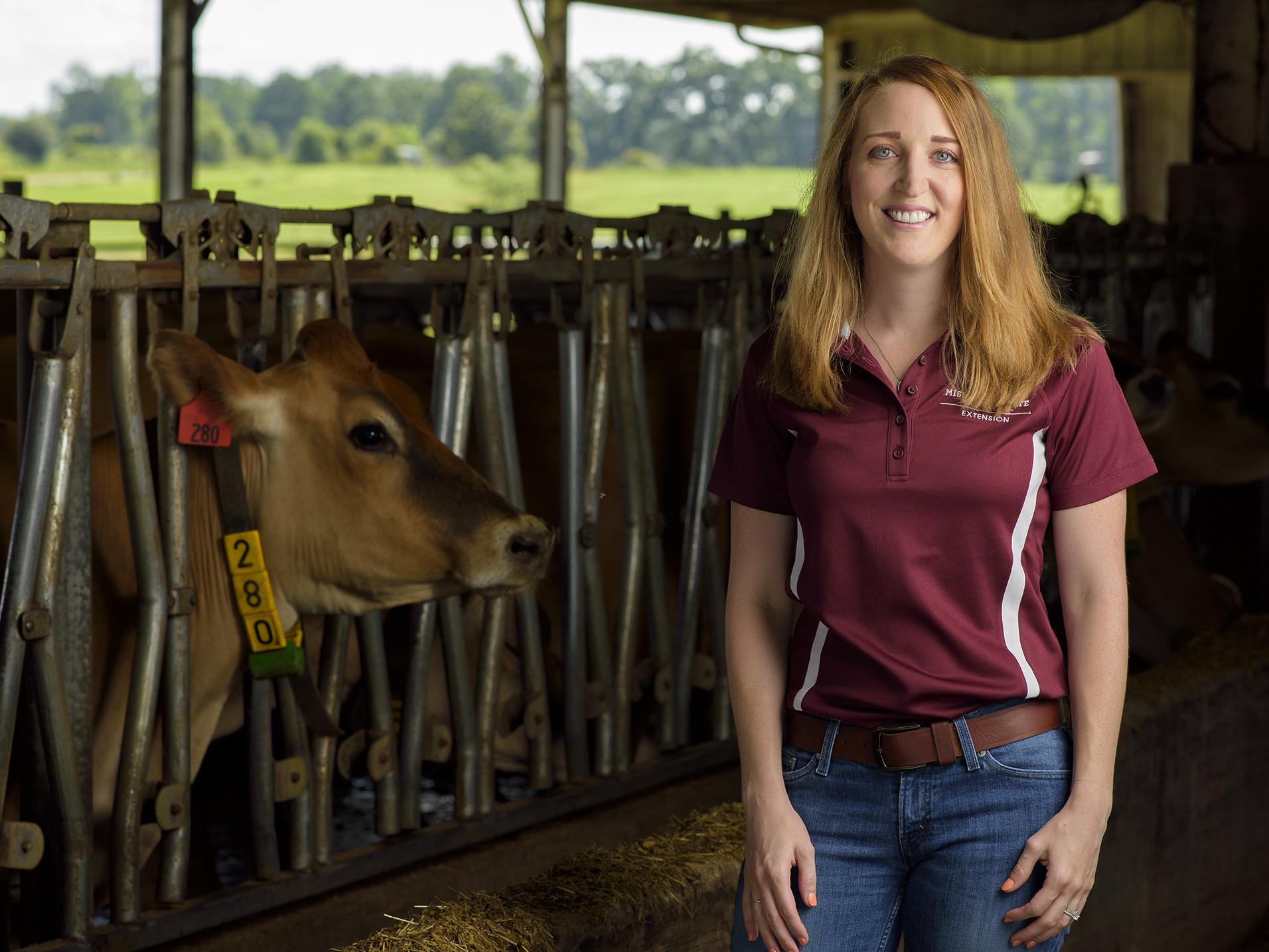Amanda Stone, dairy specialist with the Mississippi State University Extension Service, studies the herd at the MSU Bearden Dairy Unit and brings the latest research-based information to the state's dairy producers. (Photo by MSU Extension Service/Kevin Hudson)