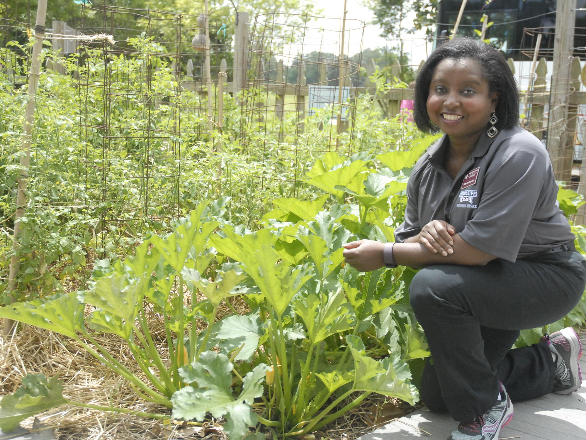 Natasha Haynes, Mississippi State University Extension agent in Rankin County, advocates choosing one local ingredient to spotlight in a menu, such as this squash growing at the Southern Heritage Garden at the Vicksburg National Military Park on June 13, 2017. (Photo by MSU Extension Service/Bonnie Coblentz)