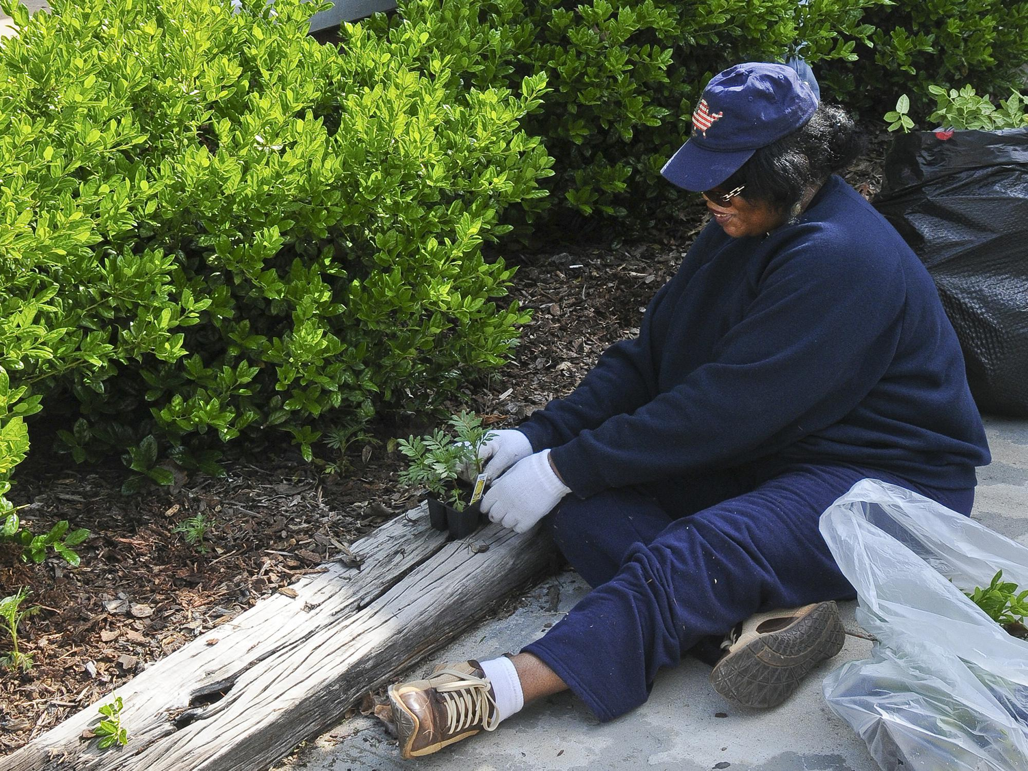 Real gardeners know the work is hard, but they consider sweat equity a reasonable price to pay to be able to enjoy their landscapes. (File Photo by MSU Extension)