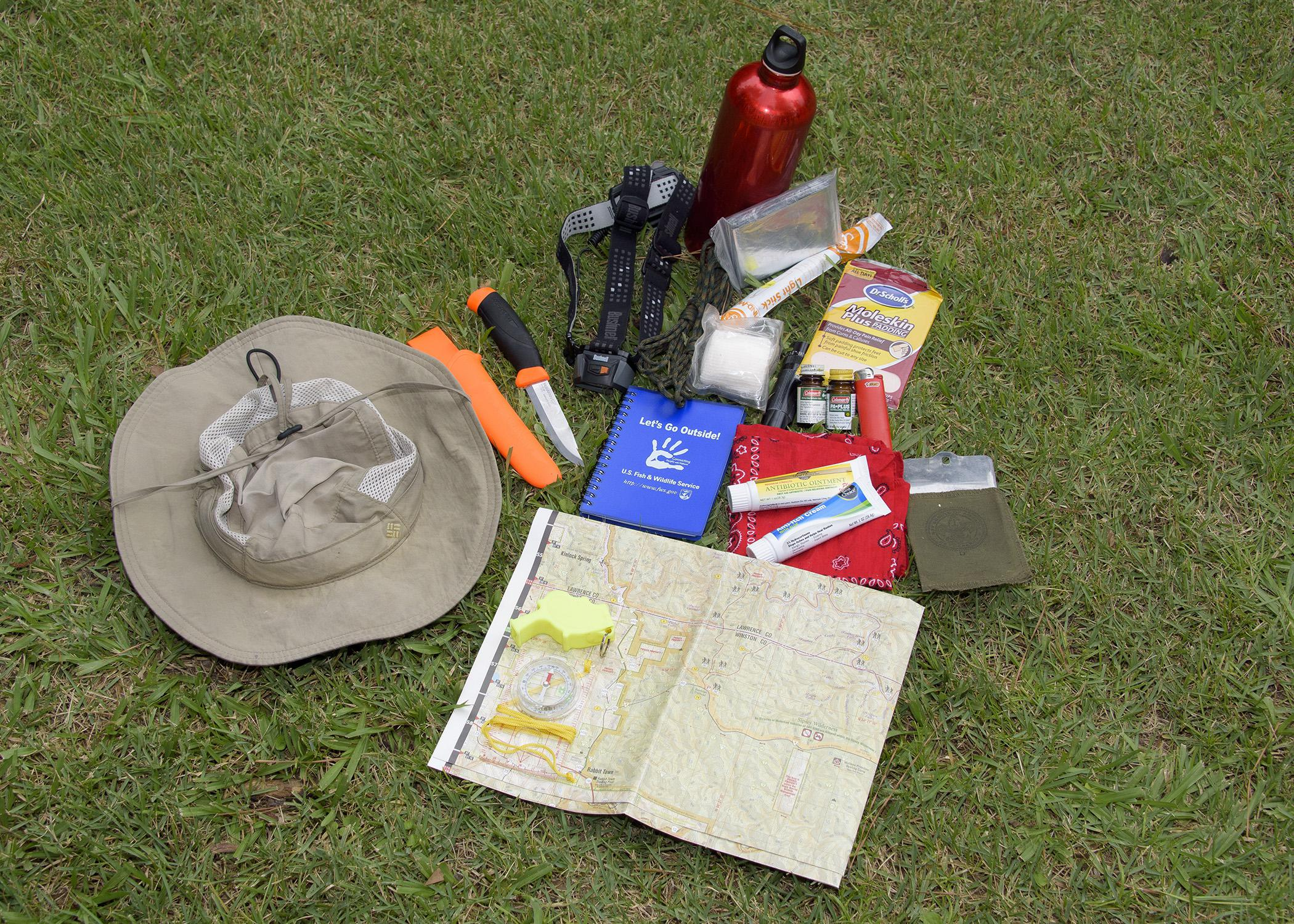 Being prepared for outdoor adventures includes carrying a hiking kit with a map, compass, flashlight, knife, whistle, first-aid items, water and protection from the seasonal elements. (Photo by MSU Ag Communications/Kevin Hudson)