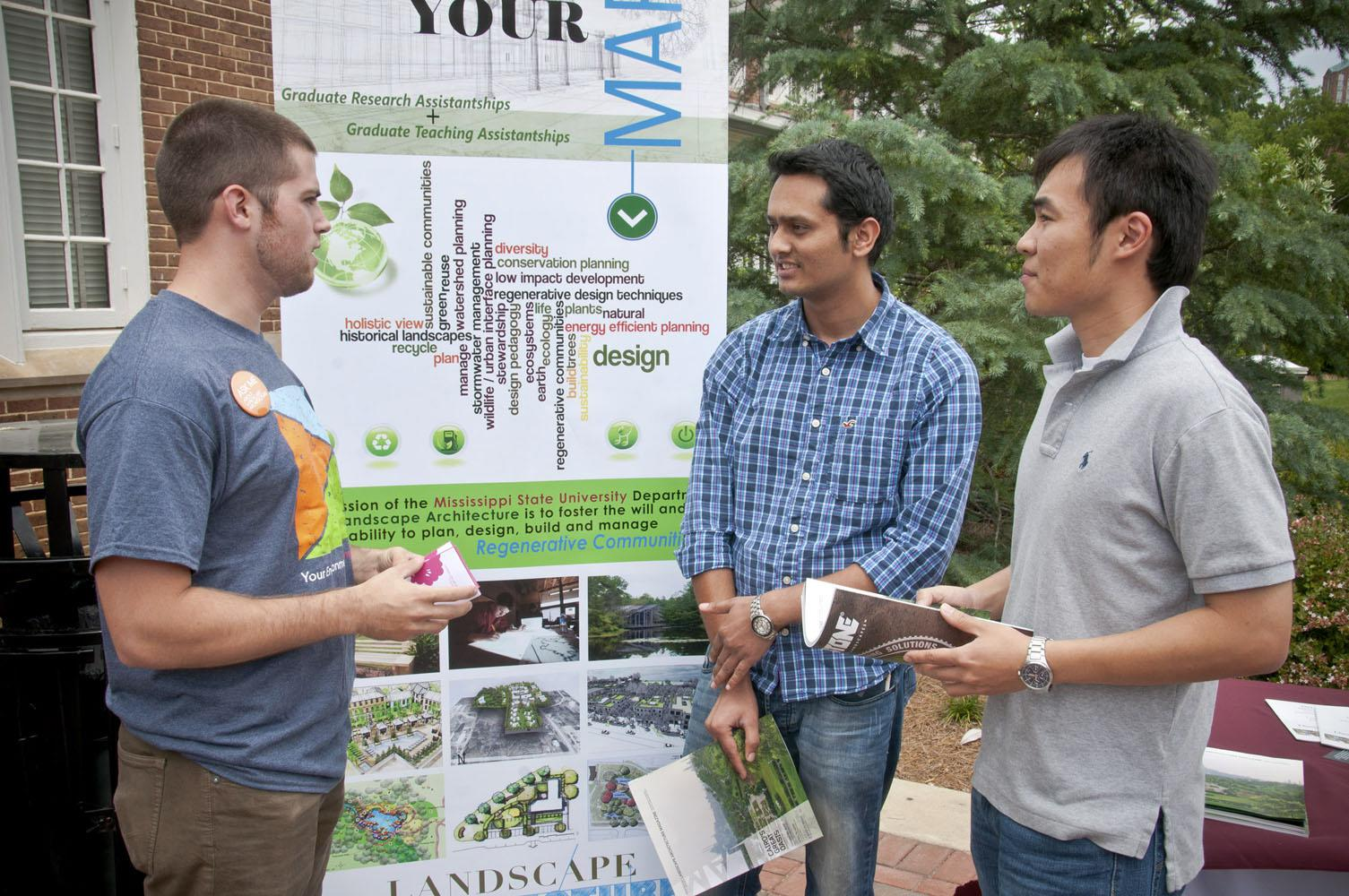 Mississippi State University senior landscape architecture student Owen Harris (left) speaks to Ranjit Amgai (center), an electrical engineering graduate student from Nepal, and Shengyi Pan, a computer engineering doctoral student from China, about the role of landscape architects in the environment. Landscape architects and students are celebrating National Landscape Architecture Month with outreach activities to promote their program and discipline. (Photo by MSU Ag Communications/Scott Corey)