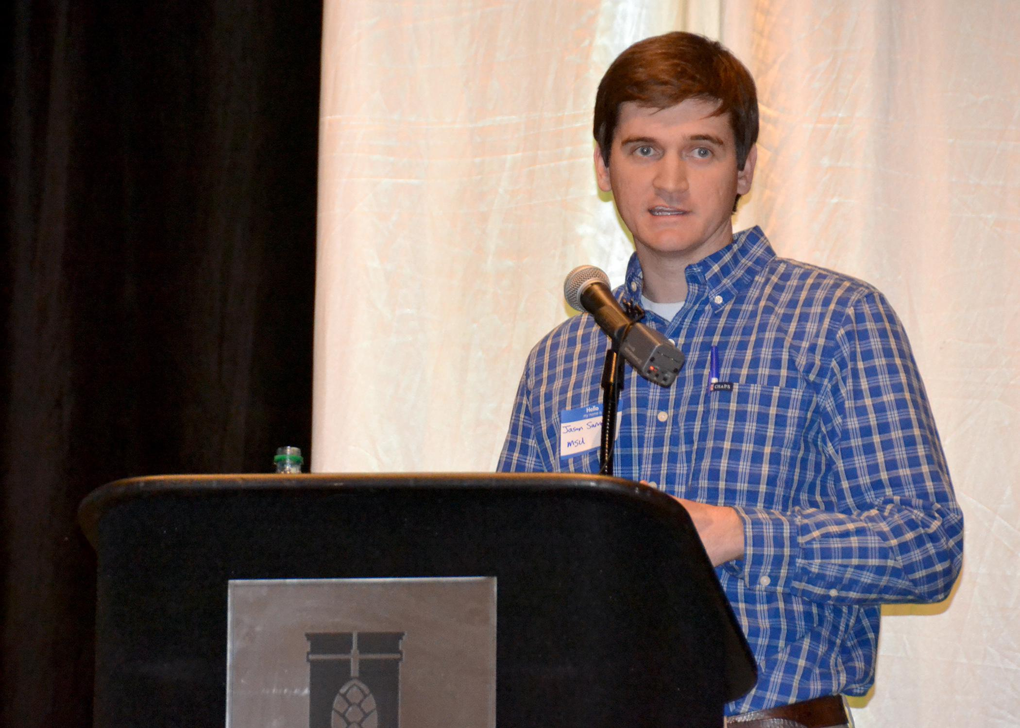 Jason Sarver, newly-hired peanut specialist with the Mississippi State University Extension Service and Mississippi Agricultural and Forestry Experiment Station, told a crowd of growers and industry representatives his research plans for the crop during the 9th annual Mississippi Peanut Growers Association meeting in Hattiesburg Feb. 12. The two-day meeting continues Feb. 13 and addresses factors that influence the crop's profitability. (Photo by MSU Ag Communications/Susan Collins-Smith)