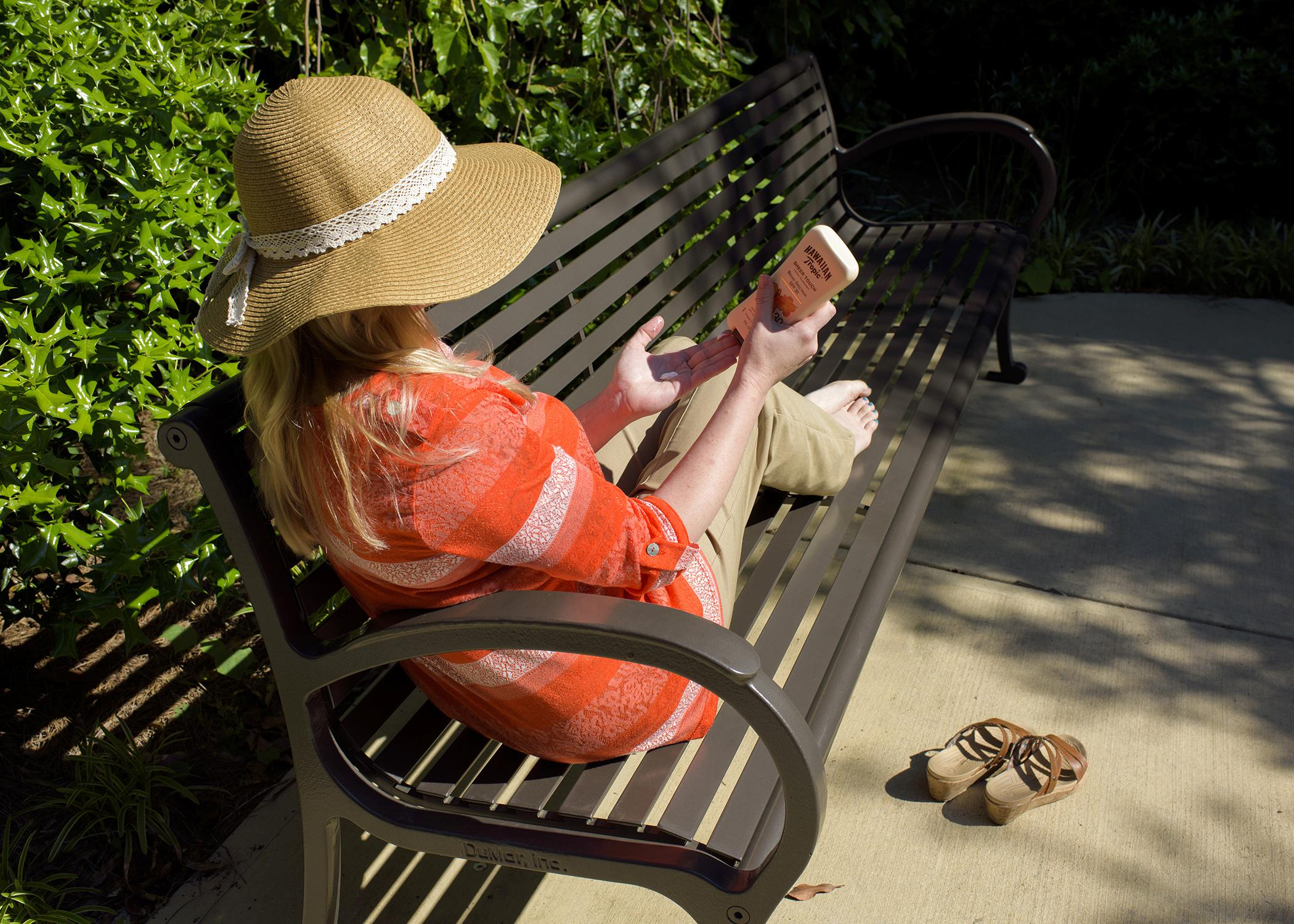 Take proper precautions, such as wearing a wide-brimmed hat and applying sunscreen, to protect skin from sun damage and help prevent skin cancer. (Photo by MSU Ag Communications/Kevin Hudson)